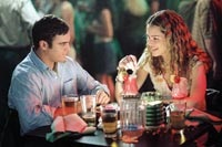 Jack and Linda Morrison (Joaquin Phoenix and Jacinda Barrett) enjoy a romantic dinner
