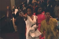 The movie literally starts with a bang, as Michelle (Kimberly Elise) pulls a gun in church