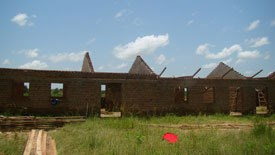 Plans to build a school at the orphanage are on hold.