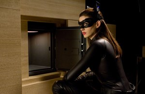 Anne Hathaway as Selina Kyle and Catwoman
