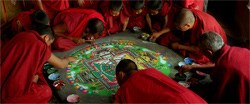 Buddhist monks and a communal work of art