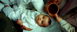 An infant awaits baptism