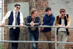 Marcus Mumford (left) and his bandmates