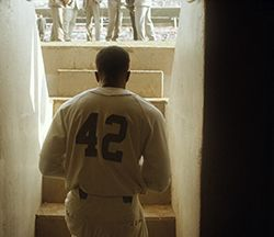 Chadwick Boseman as Jackie Robinson in 42.