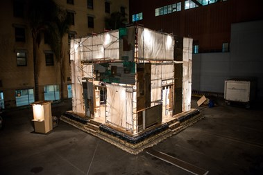 """""""Sacred Streets,"""" Leith's art installation, features 12 portraits of homeless people on Skid Row, where the installation is located."""