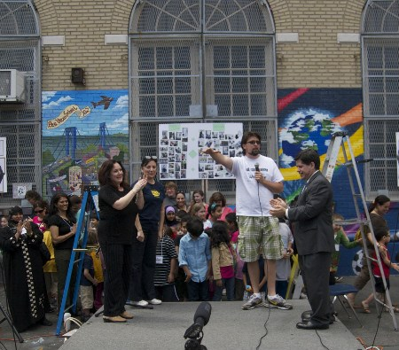 Jay and other community leaders mark the completion of the school Welcome mural in 2011.