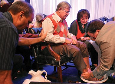 Peter Joudry washes feet of former pastor Don Fisher.