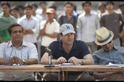 Jon Hamm and J.K. Simmons in 'Million Dollar Arm'