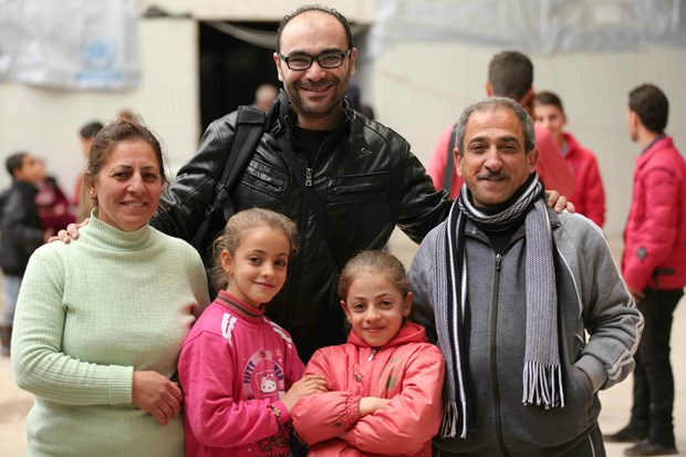 Myriam's family with SAT-7 journalist.