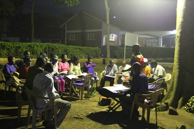 A group of Ugandan churchgoers practice their choir songs on the park-like grounds of the Catholic Martyrs' Shrine.