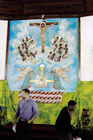 Artwork inside the basilica at the Catholic Martyrs' Shrine shows the young martyrs clothed in white and lifting their arms to Jesus.