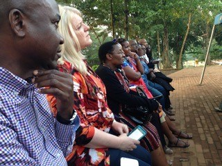 Journalists visiting from Nigeria, Uganda, Kenya, Tanzania, and the United States listen to a tour guide describing the history at the Catholic Martyrs' Shrine.