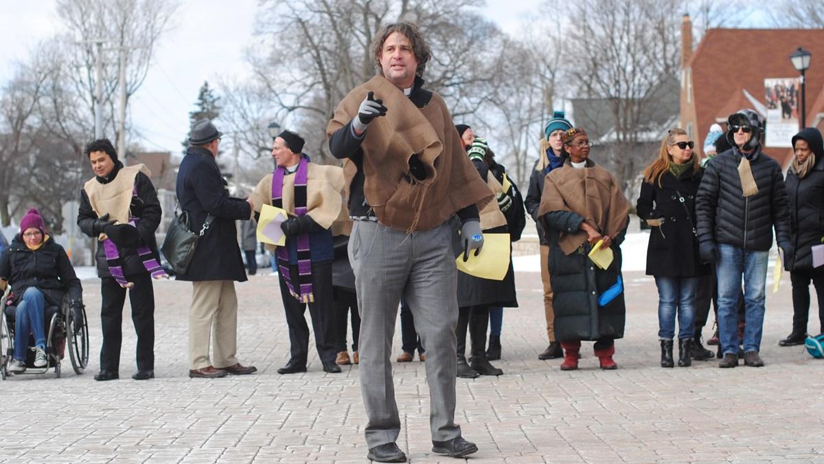 Wheaton alumnus Peter Heltzel leads protesters.