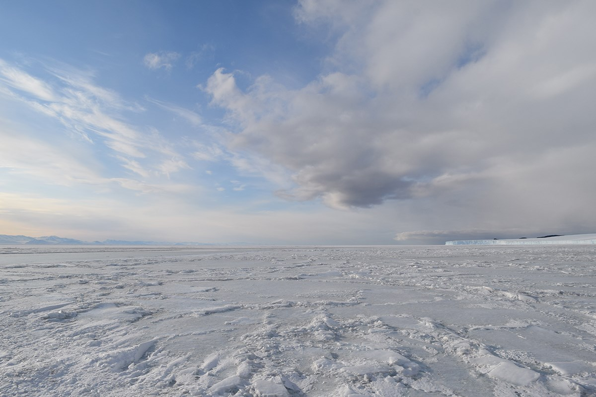 While standing on the sea ice at Cape Evans, Captain Robert Falcon Scott's home prior to venturing to the South Pole, one can see the Transantarctic Mountain range (left) well over thirty miles away as well as an ice cliff formed by the glaciers of Ross Island (right).
