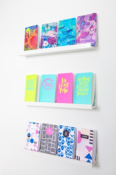 May Designs journals on display. The journal designs featuring butterflies and airplanes are part of the Rise Art Collection, which supports early intervention and inclusive education for children with special needs.