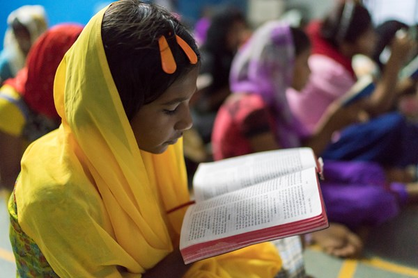 A student at a Christian school reads her Bible.