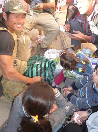 A Mosul family receives help from FBR medic Joseph, who is from Burma's Karen state.