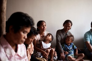 A mother of six, Pang Siphon shares her testimony about taking a job as a domestic worker in Malaysia at a weekly Bible study organized by World Relief to teach families about safe migration.