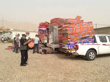Displaced Iraqi Christians receive mattresses and blankets.