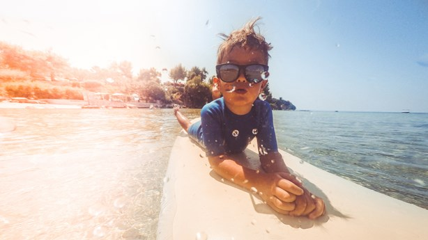 Little Surfer Feels Safe Because His Father is Watching