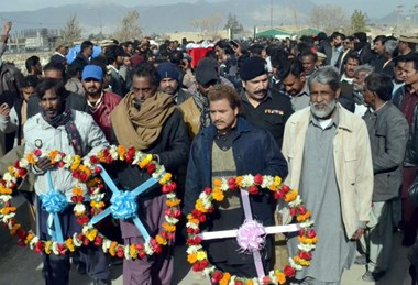 Mourners carry wreaths at the funeral of victims of the Bethel Memorial Church bombing, Quetta, Pakistan.