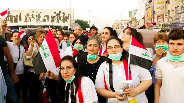 Members of National Baptist Church in Baghdad's Tahrir Square.