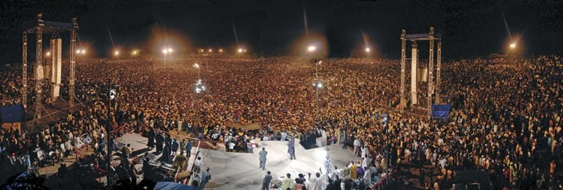 A large crowd surrounds the stage as Reinhard Bonnke holds a crusade in 2006 in Africa.