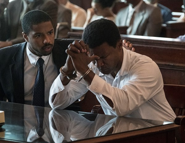 MICHAEL B. JORDAN as Bryan Stevenson and JAMIE FOXX as Walter McMillian in Warner Bros. Pictures drama, JUST MERCY, a Warner Bros. Pictures release.