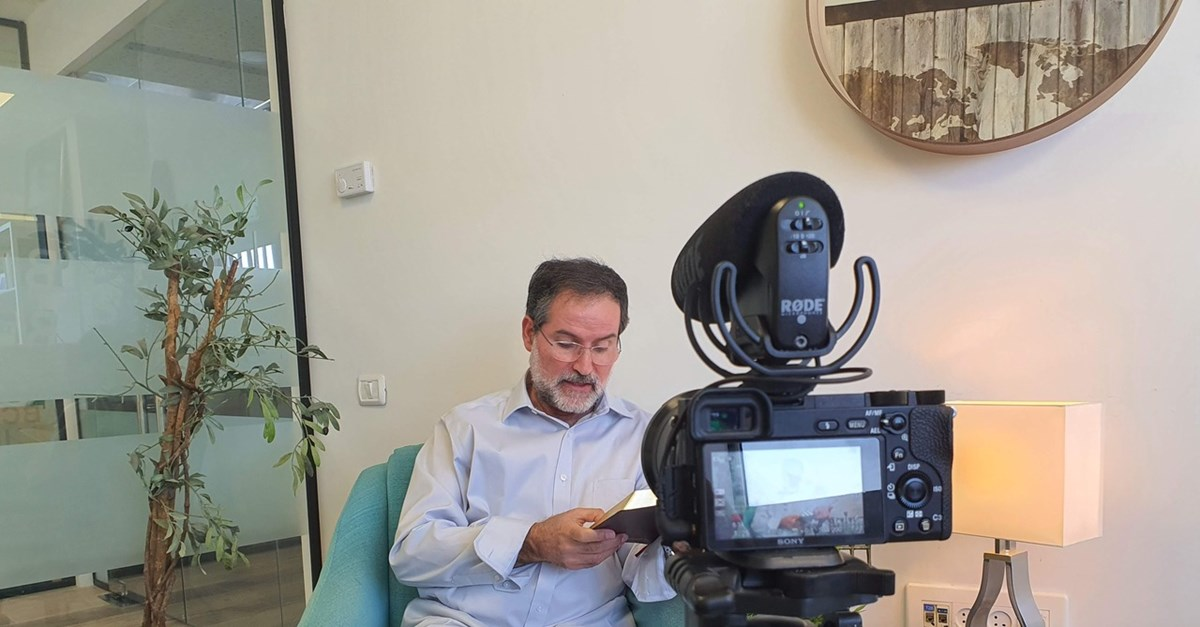 Avi Mizrachi, a Shelanu board member and a native-born Israel Messianic leader, reads to camera.