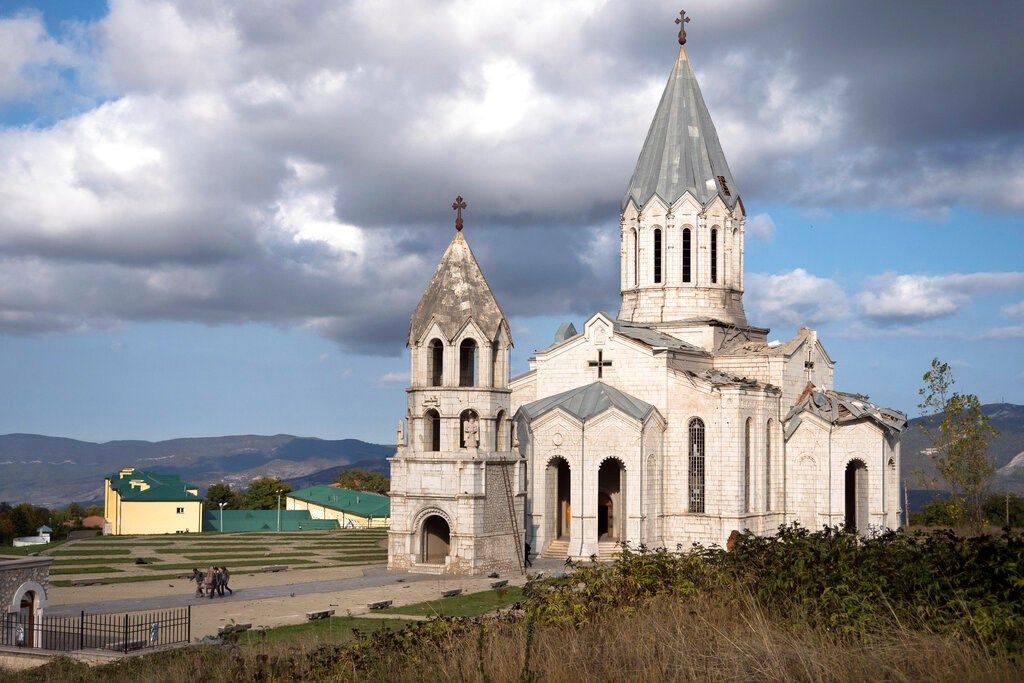 Men carry out furniture from the Holy Savior Cathedral damaged by shelling during a military conflict, in Shushi, outside Stepanakert, self-proclaimed Republic of Nagorno-Karabakh on October 8.