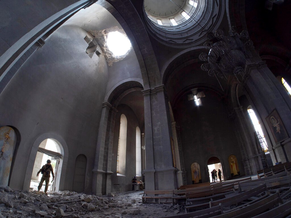 A hole made by shell in the roof of the Holy Savior Cathedral during a military conflict, in Shushi, outside Stepanakert, self-proclaimed Republic of Nagorno-Karabakh on October 8.