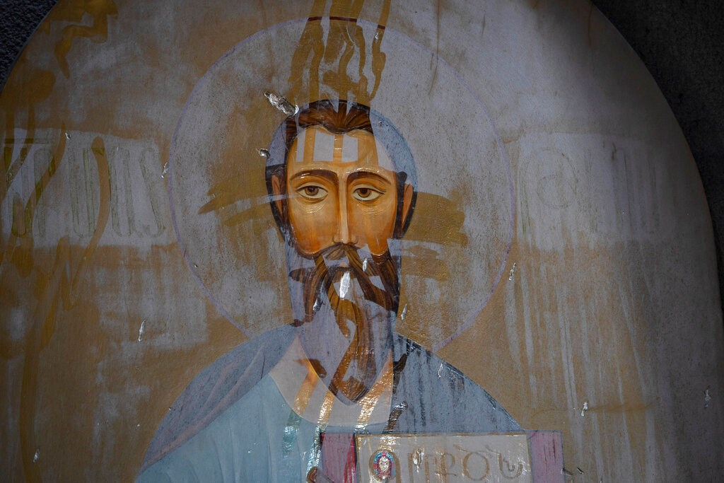 An icon covered with dust in the Holy Savior Cathedral damaged by shelling during a military conflict, in Shushi, outside Stepanakert, self-proclaimed Republic of Nagorno-Karabakh on October 8.