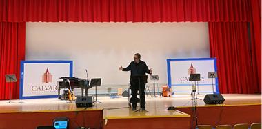 Preaching in person at Calvary Baptist Church.