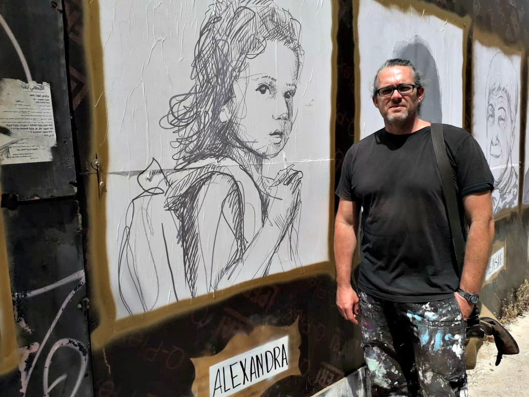 Brady Black stands in front of his #TheyMatter street art gallery in Beirut.