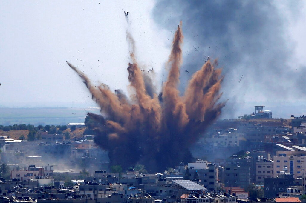 Smoke rises following Israeli airstrikes on a building in Gaza City on May 13, 2021.