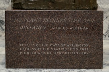An engraving on the base of a statue of Marcus Whitman is shown in the Legislative Building at the Capitol in Olympia, Washington.