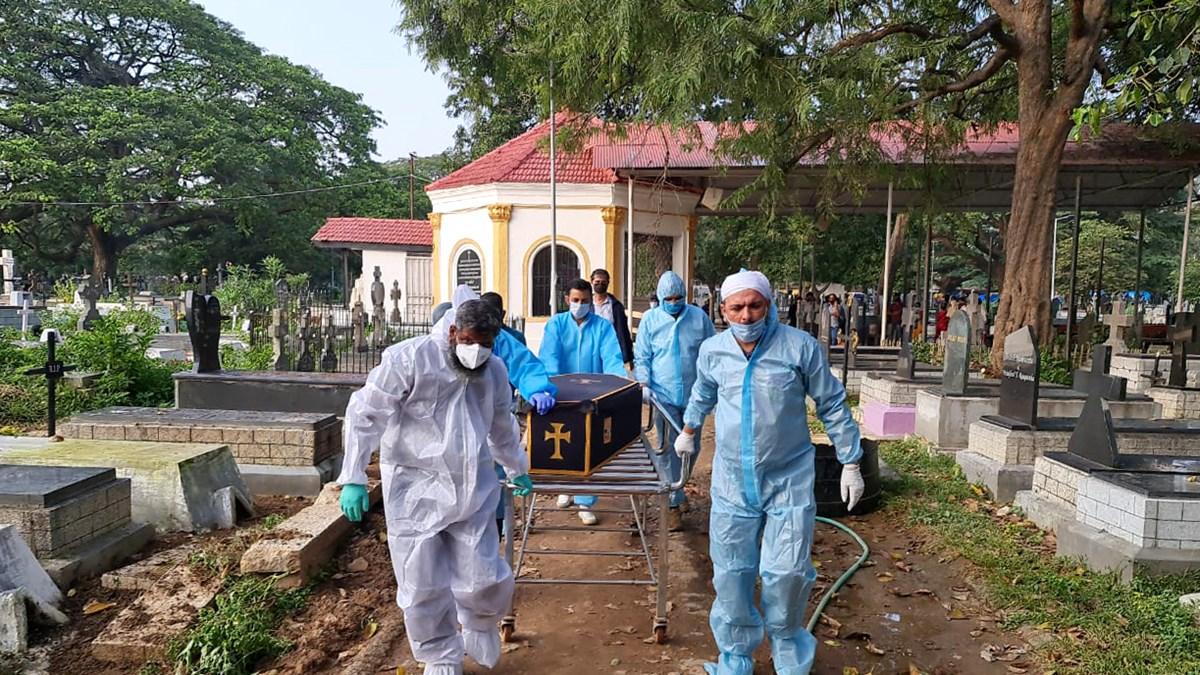 Volunteers with Mercy Mission in Bengaluru help bury deceased COVID-19 victims.