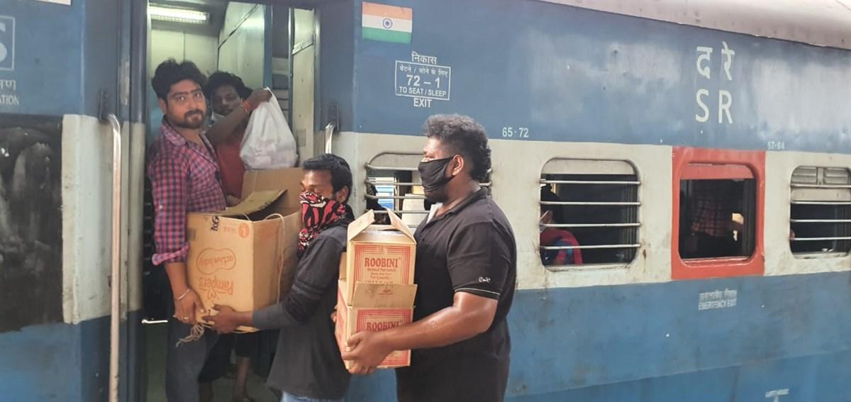 Volunteers distribute food to migrant laborers in Chennai.