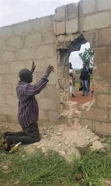 A parent prays for students abducted through a breached wall at Bethel Baptist High School in Kaduna, Nigeria, on July 5.