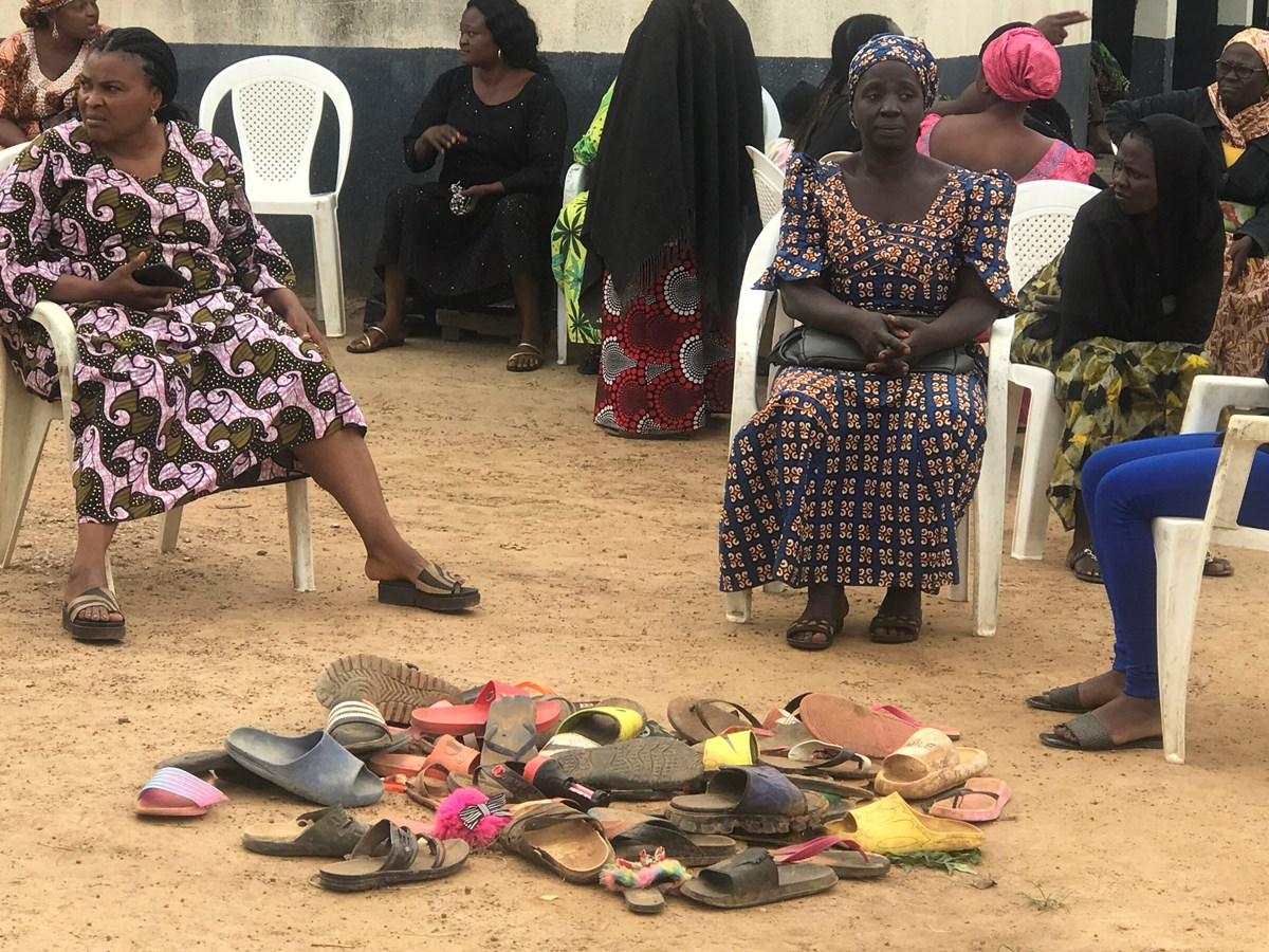 Parents wait for news by a pile of shoes left by their children abducted from Bethel Baptist High School in Damishi Kaduna, Nigeria, on July 6.