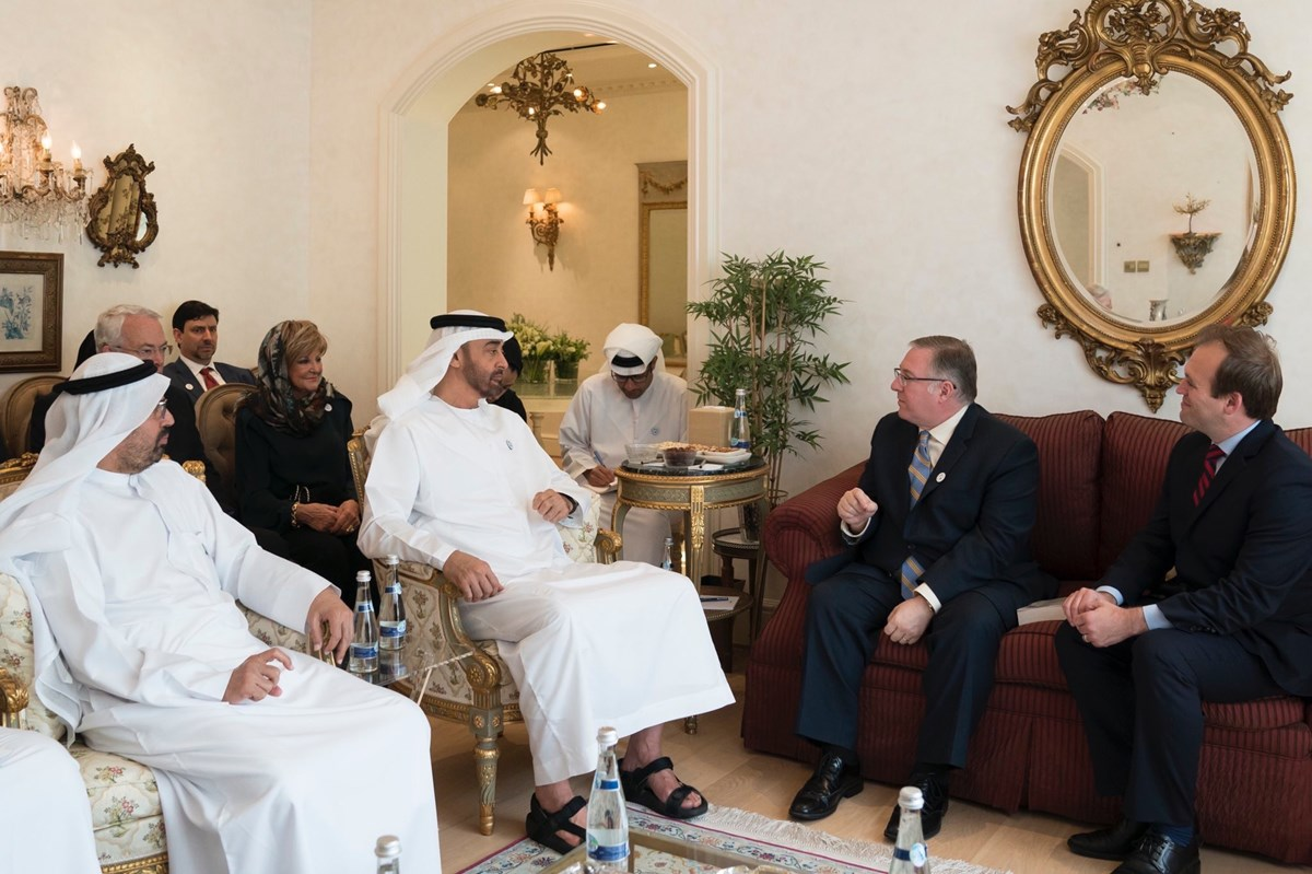 Sheikh Mohamed bin Zayed, Crown Prince of Abu Dhabi (center), welcomes a delegation of American evangelicals including Joel C. Rosenberg (left) and Johnnie Moore (right) into his home.