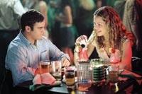 Jack and Linda Morrison (Joaquin Phoenix and Jacinda Barrett) enjoy a romantic dinner