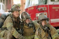 John Travolta, Kevin Chapman and Joaquin Phoenix as Baltimore firefighters
