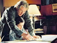 Saul Naumann (Richard Gere) helps his daughter Eliza study for the spelling bee