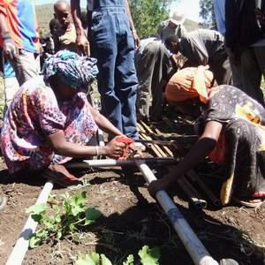 Women constructing a drill