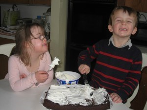 Penny and William making Marilee's birthday cake