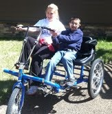 Peter loves riding the double-seated bicycle at Jill's House.