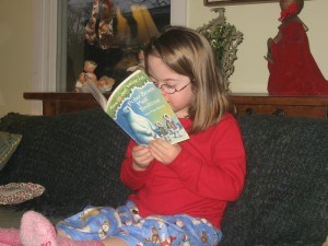 Penny reads one of her new books on Christmas Day