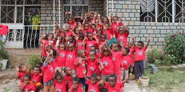 The children in front of Bright Future Academy