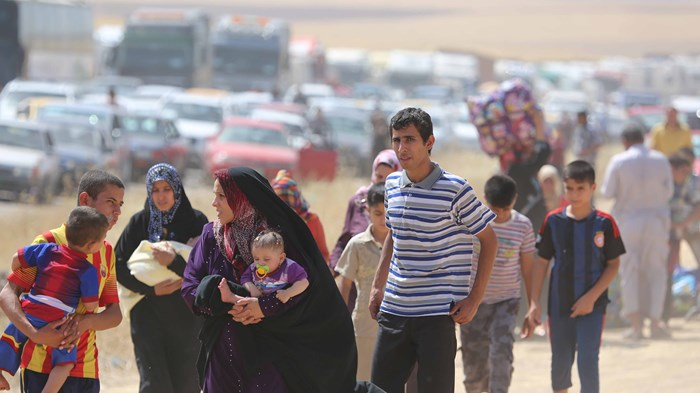 Thousands Flee as Terrorists Take Over Iraq's Christian Heartland